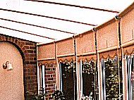 Technoshade roof blinds and roller blinds complete this conservatory